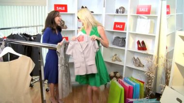 Girlfriends shopping together in exclusive fashion boutique