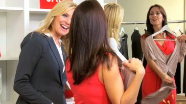 Blonde Boutique Manager Helping Fashion Conscious Client — Stock Video