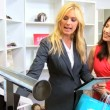 Stock Video: Boutique Client Viewing Online Collection