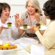 图库视频影像: Retired Girlfriends Enjoying Tea Cakes and Gossip