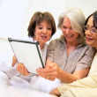 Senior Females Using Wireless Tablet — Vídeo de stock