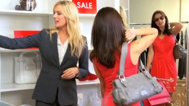 Caucasian Store Assistant with Female Shopper — Stock Video