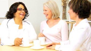 Older Ladies Drinking Coffee Home — Stock Video