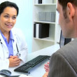 Stock Video: Female Medical Consultant Meeting Business Advisor