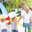 Stock Video: Young Family Packing Car for Trip to Beach