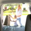 Vídeo de stock: Excited Child Preparing Beach Car Journey