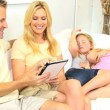 Caucasian Parents Home Using Wireless Tablet   — Vídeo Stock