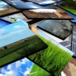 3D Tablets Featuring Global Clean Energy Production - ストック写真