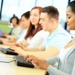 Multi ethnic university students in technology class - Stock Photo