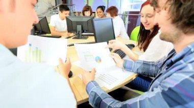 Multi ethnic classmates using college information hub — Stock Video