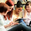 Diverse friends study online education in hub — Vídeo de stock