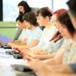 University  teacher learning students online on computers - Stock Photo
