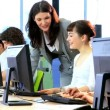 Students team with lecturer focus on project - Stock Photo