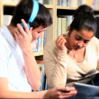Young students study and listening to mp3 player - Foto Stock