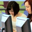 Female team of students learning education programs - Stock Photo