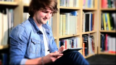 Couple researching online information for study on tablet — Stock Video
