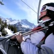 Skier on ski lift - Stock Photo