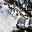 Paragliding high in the snow — Vídeo de stock