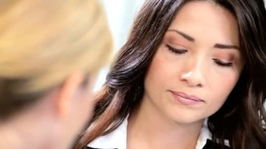 Close up Caucasian brunette successful businesswoman working with colleagues in modern office