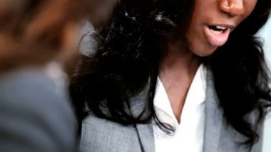 Close up ethnic businesswoman managing team of professional adviser in modern office