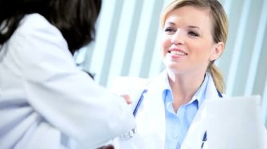 Handshake of diverse female doctors consulting patient care — Stock Video