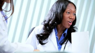 Multi ethnic female doctors finishing clinical trials with handshake — Stock Video
