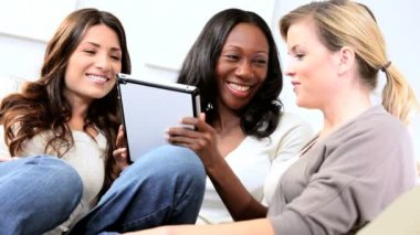 Attractive diverse friends social networking on tablet — Stock Video