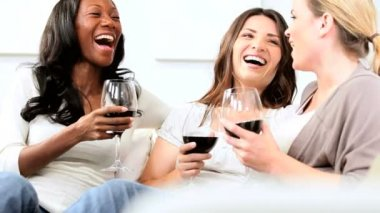 Multi ethnic girlfriends chilling with glasses of red wine — Stock Video