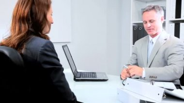 Businesswoman Meeting Bank Official — Stock Video