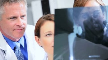 Close up Hospital Doctors Radiologist Checking X-Ray Film — Stock Video