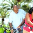 Mature diverse couple getting ready for cycling — Stock Video #18512409