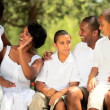 Ethnic family outdoors relaxation learning high five — Stock Video