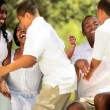 Vídeo Stock: Diverse sister and brothers spending time with parents