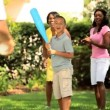 Ethnic happy family playing baseball on vacation — Vídeo de stock #18517651