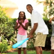 Friendly baseball game of ethnic family in garden — Vídeo de stock