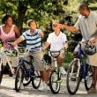 Ethnic family cycling fitness on vacation - Stock Photo