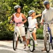 Ethnic family keeping fit together out cycling — Stock Video #18518747