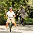 Ethnic family enjoying keeping fit cycling on vacation — Vídeo de stock