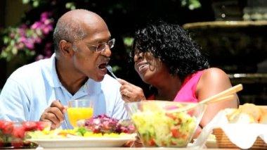 Senior ethnic couple enjoying low fat lunch — Stock Video