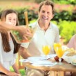 Caucasian family sharing healthy lunch - Stock Photo