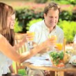 Parents with daughters have healthy low fat lunch - Stock Photo