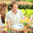 Caucasian family enjoying lunch picnic — Vídeo de stock