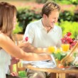 Young family enjoying healthy meal — Vídeo de stock #18524043