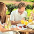 Caucasian parents eating with daughters healthy lunch — 图库视频影像 #18524361