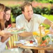Outdoor healthy picnic of young family — Vídeo de stock