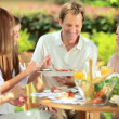 Family sharing healthy lunch in garden — Stock Video