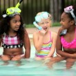 Vídeo de stock: Little diverse girls sitting together in snorkel