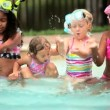 Stock Video: Multi ethnic happy girls enjoying activity in swimming pool