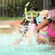 Multi ethnic children in masks splashing in swimming pool — Stockvideo