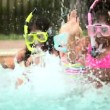 Girls on vacation using snorkel in swimming pool — Stock video